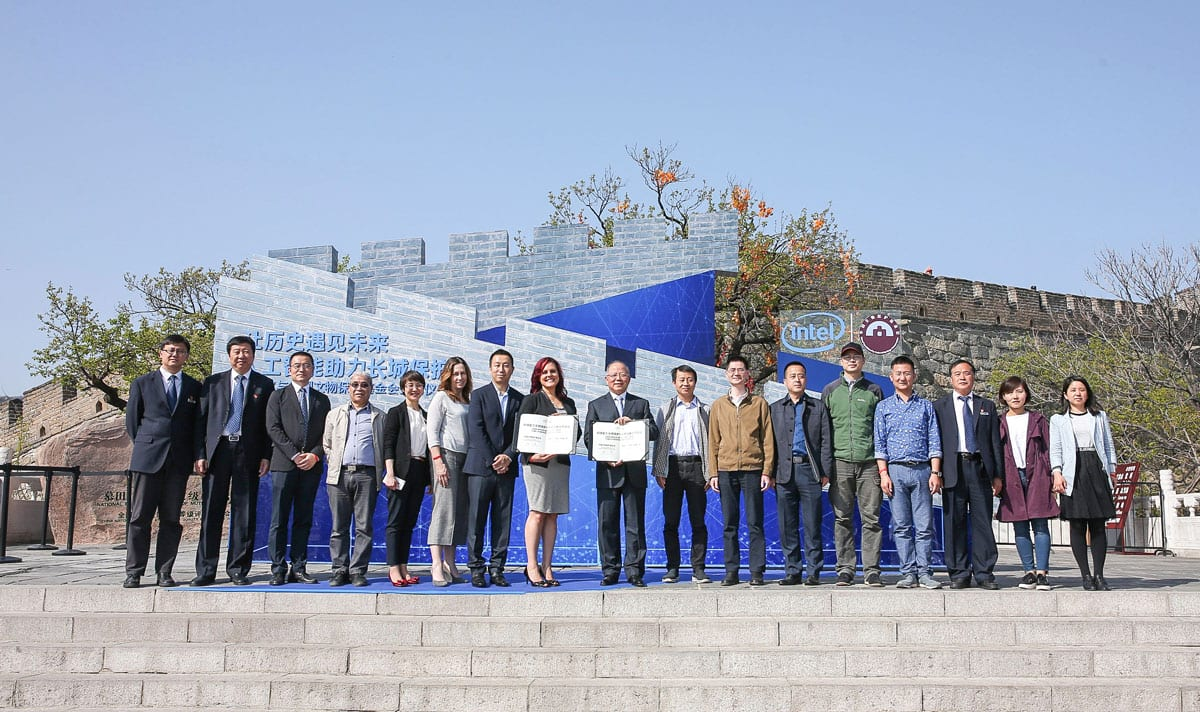 Representatives of Intel Corporation and the China Foundation for Cultural Heritage Conservation hold a signing ceremony at the Mutianyu section of the Great Wall on Wednesday, April 25, 2018, to announce a partnership to protect and restore the Great Wall of China. (Credit: Intel Corporation)