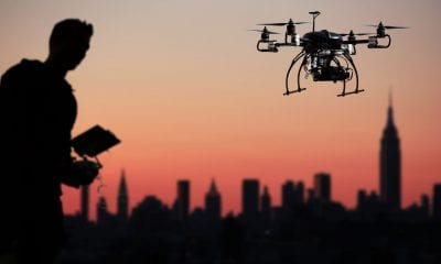Journalist flying drone over city