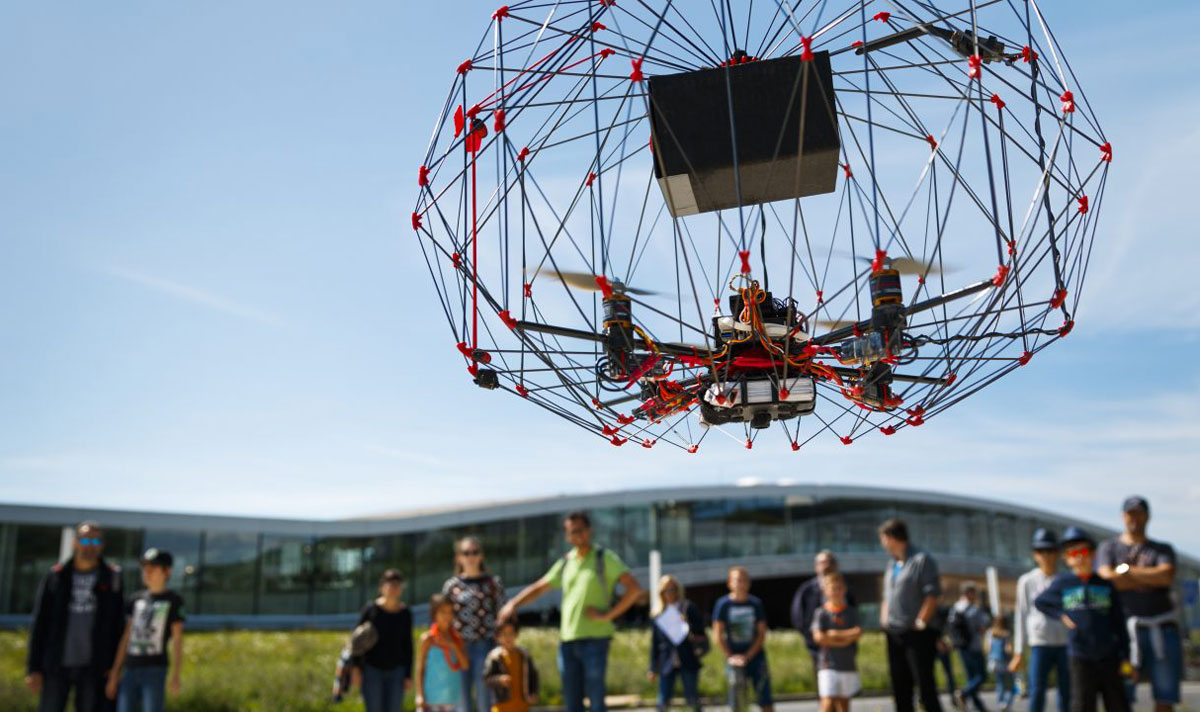 A caged autonomous cargo drone flies in front of the education center during the EPFL drone days at the Swiss Federal Institute of Technology (EPFL) in Lausanne, Switzerland, 03 September 2017