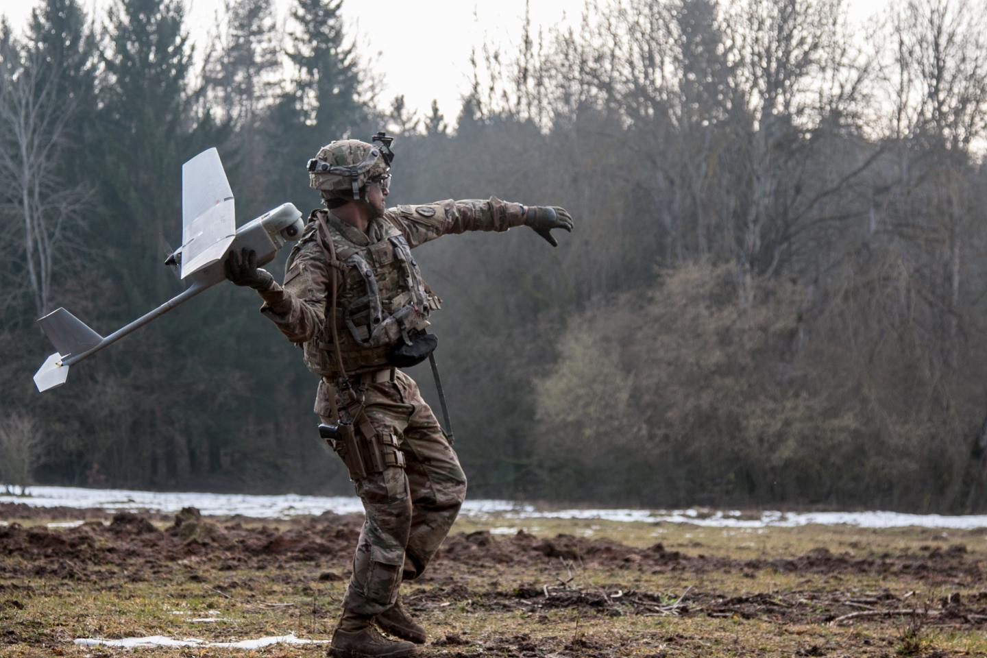 Army Spc. William Ritter prepares to launch the RQ-11 Raven, a small unmanned aerial system into the air during a 2018 training event. Credit. U.S. Army photo by Spc. Dustin D. Biven / 22nd Mobile Public Affairs Detachment